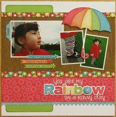 A Doodlebug Flower Box Rainy Day with Rainbow Umbrella layout by Mendi Yoshikawa.