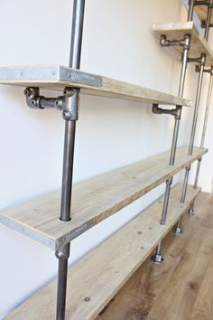 Scaffolding Boards and Dark Steel Pipe Wall by inspiritdeco
