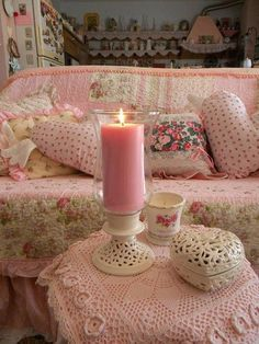 Pink candle lights up the pink living room in the pink guesthouse..so vintage pink.