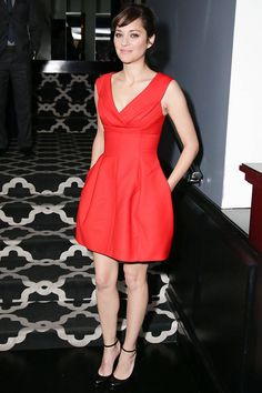 Marion Cotillard tries on a new designer- and looks insanely chic.