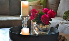"Tray,Candles, and Flowers in a Round Vase. (""Beautiful Red Rose In Globe Glass Vase And Silver Candle Holder On Black Round Tray As Sweet Coffee Table Decor Also Gray Fabric"")Sectional Couch And Cushion As Inspiring Romantic Living Room Decoration Views Coffee Table Styling, Decorating Coffee Tables, Tray Styling, Styling Tips, Romantic Living Room, Silver Candle Holders, Beautiful Red Roses, Beautiful Candles, Beautiful Things"