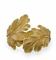 A GOLD BRACELET, BY BUCCELLATI  The tapered 18k matte gold cuff designed as two overlapping sculpted leaves, with polished 18k gold veining, 2 ins. diameter Signed Buccellati, Italy