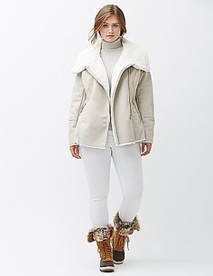 Timeless shearling meets the modern moto jacket for a chilly-day look that steals the scene. Asymmetric zipper makes the cut flattering worn open or closed, with faux fur lining and an oversized collar for a cozy finish. Zipped pockets and top-stitch detailed sleeves complete the look. lanebryant.com