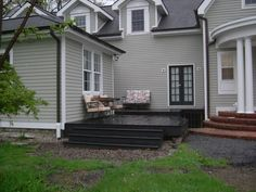 Black deck - note how it echos the roof and french doors to coordinate with the house. Learn your lesson!! Your deck should look like it belongs with your house! No more untreated wood!