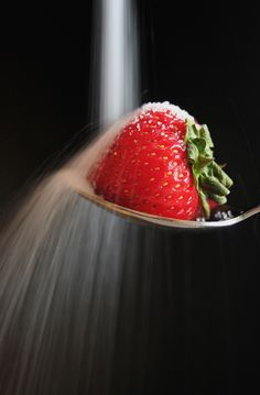 great idea unabashedly borrowed from Andrea@flickr's shot  viewed best Large On Black  longer exposure of sugar hitting a strawberry supported by a spoon.  Not nearly as striking as what I was trying to emulate, but I still like the result  Taken with kit lens, used tripod.  Edited in iPhoto for contrast and saturation only.   score me score 42, average score 8.4,  three hits on Hit Miss maybe why