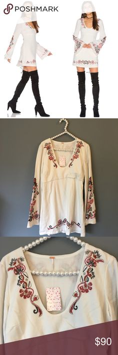 NWT Free People Embroidered Bell Sleeve Dress SO gorgeous and perfectly on trend! Great for festival season! Size 12. Beautiful embroidery throughout. Tiny nearly invisible spot to sleeve as shown. Brand new with tags and never worn. No trades!! 041517180nrt Free People Dresses Mini