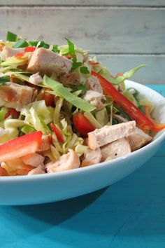 Spicy Thai Chicken Salad - A healthy, light, refreshing Asian salad made with fresh vegetables and is served with a sweet and spicy peanut sauce.