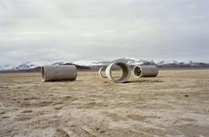 Sun Tunnels is an artwork by Nancy Holt, completed in 1976, consisting of four large concrete tubes, laid out in the desert in an open X configuration. The nine foot diameter, 18 foot-long tunnels are pierced by holes of varying size that correspond with the pattern of selected celestial constellations. There is a tunnel for Draco, Perseus, Columba and Capricorn.  The tunnels line up with the rising and falling sun of the summer and winter solstices.