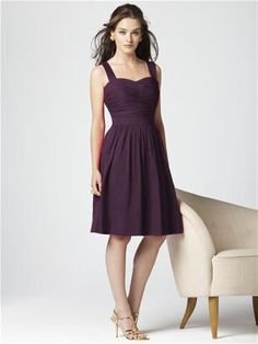 Dessy Collection Style 2856 in aubergine. Cocktail length cotton voile dress with framed sweetheart neckline and shirred bodice. Inset waistband at natural waist. Full shirred skirt has pockets at side seams and deep hem detail.