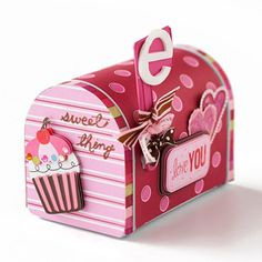Sweeten Valentine's Day with a decorated mailbox to hold your kids' cards and notes. Deanna purchased this box in the dollar section at Target. Creative Imaginations and Maya Road offer similar designs. Cover the box in seasonal patterned paper. Accent the mailbox with stickers and foam shapes.