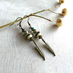 A personal favorite from my Etsy shop https://www.etsy.com/listing/261874477/boho-earrings-feather-earrings-bohemian