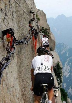 "The Dolomites , Trentino alto Adige region Italy.  ""I guess walking across this cliff wasn't adventurous enough""."