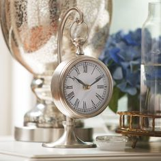 Longview Table Clock | With a striking pewter finish, this hanging clock is reminiscent of styles found in historic train stations.