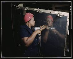 "(Courtesy  |  Library of Congress) A woman works with a hand drill on a ""Vengeance"" dive bomber, Tennessee. Feb, 1943."