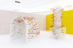 Kids stick colorful, bendable tubes into the perforations in the walls and furnishings throughout the room of this exhibition for the International Design Week in Hangzhou China