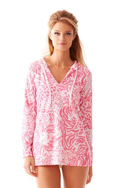 The Megan Tunic Hoodie is a long sleeve hooded tunic with a v-neck and draw strings. This towel terry tunic is our favorite on a windy beach day. It's so soft and easy to wear over your bikini. Stay out a little longer and watch the sun set (bring your own happy hour).