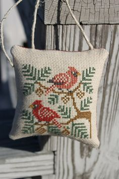 Completed Cross Stitch Cardinals in Pine Boughs by Stitchcrafts, $18.00