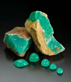 Tanzanian chrysoprase rough and cabochons. Courtesy of Dimitri Mantheakis; photo by Robert Weldon © GIA