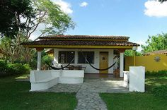 Photo Example of a a little beach cabaña with a small patio including a BBQ place