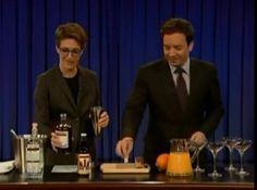 Rachel mixing up a very manly Monkey Gland cocktail on Late Night with