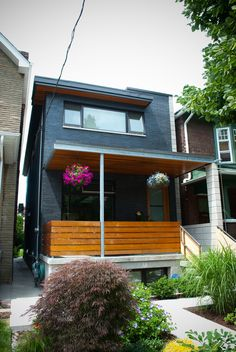Modern wood front porch. Love the contrast of wood and the dark exterior. Modern and warm