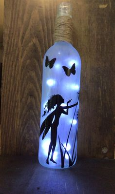 Excited to share the latest addition to my #etsy shop nikinackis : Fairy nite light Wine Bottle Art, Glass Bottle Crafts, Painted Wine Bottles, Lighted Wine Bottles, Diy Bottle, Light Up Bottles, Bottle Lights, Bottle Painting, Shabby