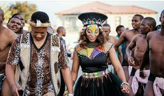 Bride in black Zulu attire with beaded belt, cape and black isicholo hat. Zulu groom in leopard print t-shirt with umblaselelo waist coat and pants. Zulu Traditional Attire, Zulu Traditional Wedding, African Traditional Dresses, Zulu Wedding, Wedding Wear, Zulu Women, Waist Coat, African Weddings, Black Bride