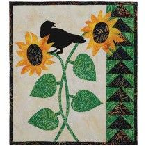 """Sunny Days Quilt Kit-A Keepsake QUICK Kit! Create this cheerful quilt for sunny summer days or for chilly winter days when the sun's gone missing! This 18"""" x 22"""" wall-sized sunflower quilt lives up to its name in this happy quilt. Kit has Sharlene McGlynn's piecing and fusible-applique dierctions, and batik fabrics for the top, binding and backing. It's super easy-- can be completed in two weekends or less."""