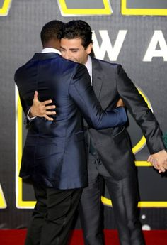 John Boyega and Oscar Isaac hug it out