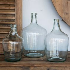 $50 each vases http://www.antiquefarmhouse.com/huge-recycled-glass-cellar-bottles.html