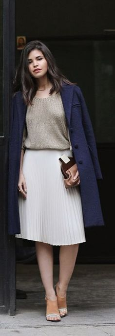 Chic in a white pleated midi skirt.