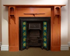 Historical cast-iron fireplace with hardwood mantel and ceramic tiles of South Africa's proteas and hibiscus. // Church of Scientology Pretoria