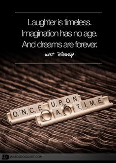 """A cute picture of the Bride and Groom's wedding rings placed with scrabble pieces that read """"Once upon a time"""".  Included is a quote from Walt Disney about laughter, imagination and dreams."""