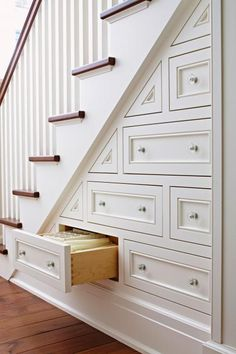 Great way to add storage under stairs! Click for more storage and organizing ideas.