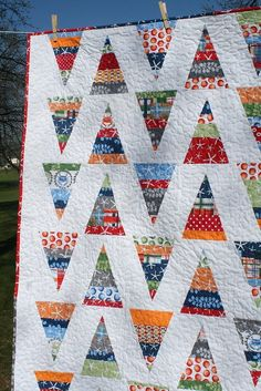 Scrappy Triangles by freshlypieced, via Flickr. LOOKING FOR WAYS TO USE UP MY SCRAPS.