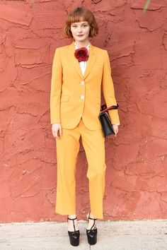 Kacy Hill - Wallflowers, look away: saffron packs a punch when paired with slick black Gucci platforms. Add a corsage at the neck (not the lapel) if you bear no resemblance to an Eighties-era Molly Ringwald.
