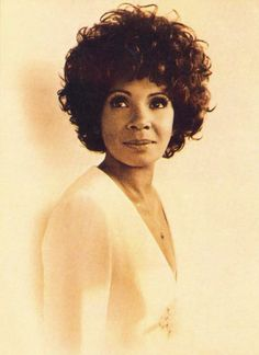 Dame Shirley Bassey....tried to sing like her and copy her hand motions in front of the mirror as a child....love her.