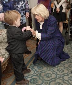 Camilla and one of the youngsters at her annual festive party for sick children at Clarence House.