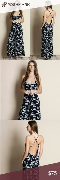 Floral Print Crossback Jumpsuit Floral print crossback jumpsuit.  Modeling size small.  True to size.  Navy Pants Jumpsuits & Rompers