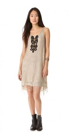 GOLDEN SANDS DRESS $180.54 SPECIAL $50.40 YOU SAVE: 72% Sequins flash amid open stitches on a flapper-inspired Free People dress. Metal studs accent the contrast appliqué in the front, and the hem is trimmed with a flirty fringe. Sleeveless. Lined.