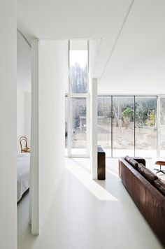 white room with long couch.