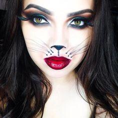 Bonito maquiagem cara do gato para o dia das bruxas.