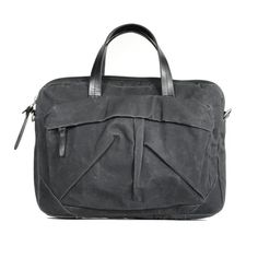 tommy laptop bag (coal) out of waxed cotton canvas and durable leather