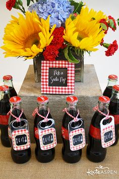 Classic soda bottles make a nice nostalgic presentation for the center of the ice cream float station. Create a cute printable chalkboard sign in a gingham frame to tell guests what to do. You can even tie custom bottle openers to the bottles for guests to keep as a favor!