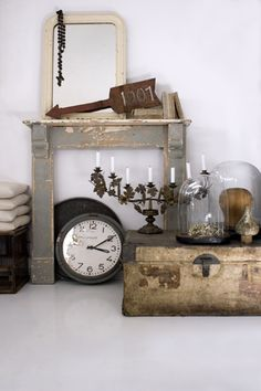 Vintage & Morrhår  (could take a candalabra and cut and wrap the metal wall hangings find at thrift stores around it)