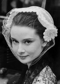 Audrey Heburn wearing a veiled bonnet, May 1951