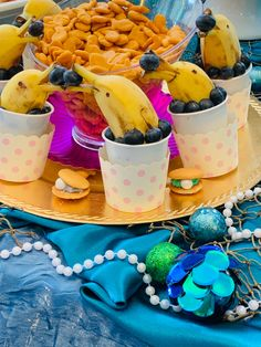 Mermaid Birthday Party DOLPHIN Bananas Food Ideas How cute are these bananas cut to look like adorable dolphins? If you're looking for amazing mermaid or under the sea birthday party ideas, you should definitely. Dolphin Birthday Parties, Underwater Birthday, Dolphin Party, Mermaid Theme Birthday, Little Mermaid Birthday, Little Mermaid Parties, Birthday Party Themes, Sea Themed Party Food, Dolphin Food