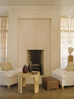 Jean-Michel Frank armchairs, Jacques Adnet parchment table . http://www.1stdibs.com/introspective-magazine/frank-de-biasi/
