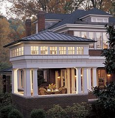 When porch becomes lantern. Capping a porch with a clerestory and a pyramid roof adds up to an outdoor space that becomes a giant beacon at night.