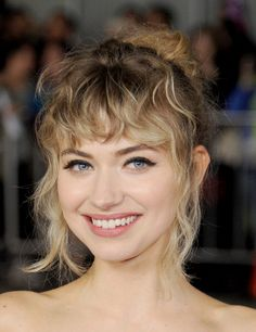 Imogen Poots haircut. A closer look at Imogen Poots's short, blond, curly hairstyle.